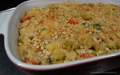 Macaroni-ovenschotel met kip, courgette, snoeptomaatjes en mozzarella